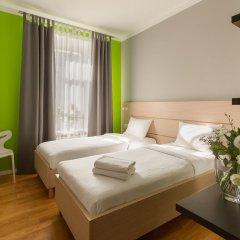Гостиница УНО комната для гостей фото 5