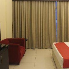 Апартаменты OYO 133 Home Studio Tecom Al Barsha удобства в номере