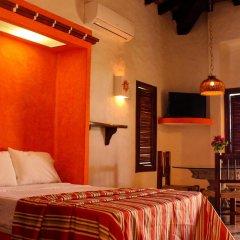 Hotel Plaza Tucanes комната для гостей
