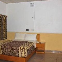 Отель Jacaranda Suites Нигерия, Калабар - отзывы, цены и фото номеров - забронировать отель Jacaranda Suites онлайн комната для гостей