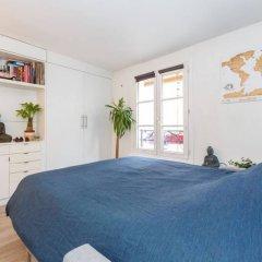 Апартаменты Bright Studio in Paris 18th комната для гостей