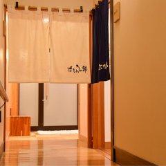 Отель Ochimizu no Yu Tsutaya Цуруока сейф в номере