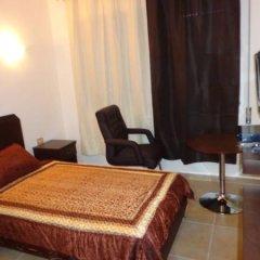 Отель Noor Hotel Apartments Иордания, Солт - отзывы, цены и фото номеров - забронировать отель Noor Hotel Apartments онлайн комната для гостей