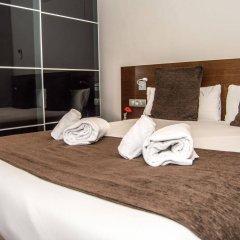 Отель Apartamentos Madanis - Hospitalet de Llobregat Испания, Оспиталет-де-Льобрегат - отзывы, цены и фото номеров - забронировать отель Apartamentos Madanis - Hospitalet de Llobregat онлайн комната для гостей фото 3