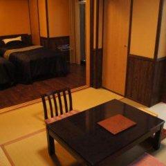Отель Fumoto Ryokan Япония, Минамиогуни - отзывы, цены и фото номеров - забронировать отель Fumoto Ryokan онлайн комната для гостей