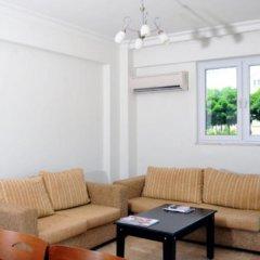 Апартаменты Hisar Garden Apartments Олудениз комната для гостей фото 5