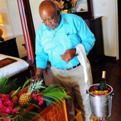 Отель Beachcombers Hotel Сент-Винсент и Гренадины, Остров Бекия - отзывы, цены и фото номеров - забронировать отель Beachcombers Hotel онлайн интерьер отеля фото 2