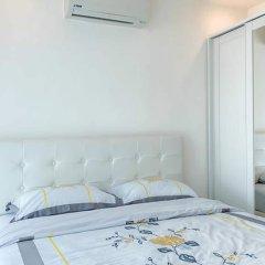 Отель Cosy Beach View Condominium Official Паттайя комната для гостей фото 5