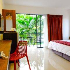 Отель The Umbrella House удобства в номере