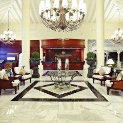 Отель Luxury Bahia Principe Esmeralda - All Inclusive Доминикана, Пунта Кана - 10 отзывов об отеле, цены и фото номеров - забронировать отель Luxury Bahia Principe Esmeralda - All Inclusive онлайн интерьер отеля