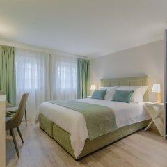 Отель Ver Belem Suites сейф в номере