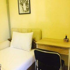Отель Mangosteen Bangkok Sukhumvit Бангкок сейф в номере