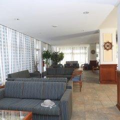 Jacaranda Hotel Apartments интерьер отеля