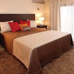 Апартаменты Amendoeira Golf Resort - Apartments and villas комната для гостей фото 7