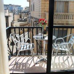 Отель Seashells Self Catering Apartment Мальта, Буджибба - отзывы, цены и фото номеров - забронировать отель Seashells Self Catering Apartment онлайн балкон