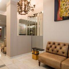 Отель Fos DownTown Suites Афины комната для гостей фото 6