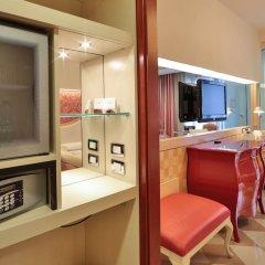 Отель UNAHOTELS Expo Fiera Milano Италия, Милан - отзывы, цены и фото номеров - забронировать отель UNAHOTELS Expo Fiera Milano онлайн сейф в номере
