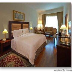 Отель Holiday Inn Bur Dubai Embassy District Дубай комната для гостей фото 2