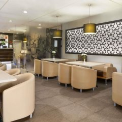 Гостиница Рамада Москва Домодедово в Москве - забронировать гостиницу Рамада Москва Домодедово, цены и фото номеров гостиничный бар