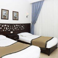 Апартаменты Pyramisa Sunset Pearl Apartments комната для гостей