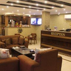 Отель Shaqilath Hotel Иордания, Вади-Муса - отзывы, цены и фото номеров - забронировать отель Shaqilath Hotel онлайн интерьер отеля