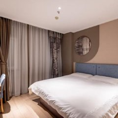 Отель Home Inn (Jiujiang Xunyang Road Pedestrian Street Branch) комната для гостей