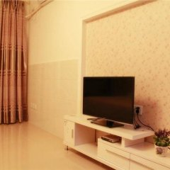 Апартаменты Xingfu Huafu Apartment комната для гостей фото 4