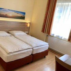 Отель Salzburgrooms Австрия, Зальцбург - отзывы, цены и фото номеров - забронировать отель Salzburgrooms онлайн комната для гостей фото 5