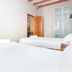 Отель AinB Las Ramblas-Guardia Apartments Испания, Барселона - 1 отзыв об отеле, цены и фото номеров - забронировать отель AinB Las Ramblas-Guardia Apartments онлайн комната для гостей фото 6