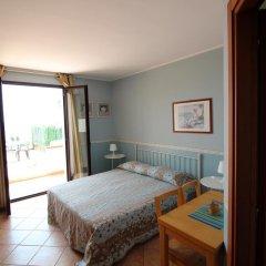 Отель Residence Del Prado Рива-Лигуре комната для гостей