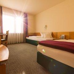 Отель Am Moosfeld Германия, Мюнхен - 3 отзыва об отеле, цены и фото номеров - забронировать отель Am Moosfeld онлайн комната для гостей фото 2