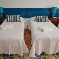 Отель 71 Castilho Guest House Лиссабон в номере