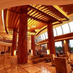 Отель Grand Soluxe Hotel & Resort, Sanya Китай, Санья - отзывы, цены и фото номеров - забронировать отель Grand Soluxe Hotel & Resort, Sanya онлайн гостиничный бар