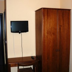 Отель Villa Rosse сейф в номере