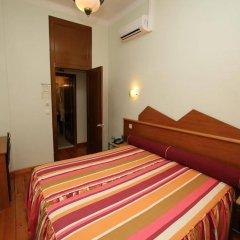 Отель Pensao Praca Da Figueira Лиссабон сейф в номере