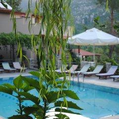 Отель Вилла Kleo Cottages бассейн