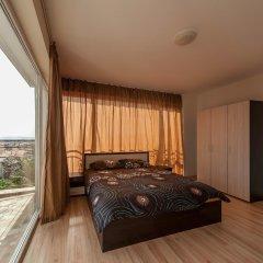 Апартаменты ROEL Residence Apartments комната для гостей