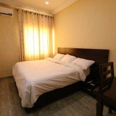 Iyore Grand Hotel & Suites 2 сейф в номере
