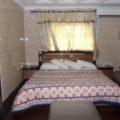 Отель Cynergy Suites Festac Town комната для гостей