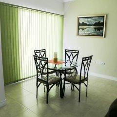 Отель Secure New Kingston Condo Ямайка, Кингстон - отзывы, цены и фото номеров - забронировать отель Secure New Kingston Condo онлайн комната для гостей фото 4
