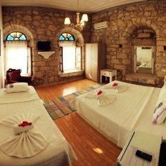 Отель Alacati Asmali Konak Otel Чешме комната для гостей фото 2