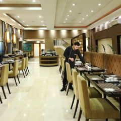 Отель City Garden Suites Manila Филиппины, Манила - 1 отзыв об отеле, цены и фото номеров - забронировать отель City Garden Suites Manila онлайн питание