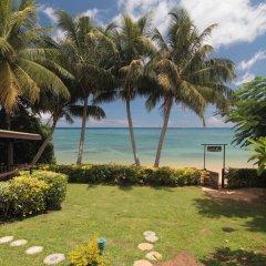 Отель Coconut Grove Beachfront Cottages пляж
