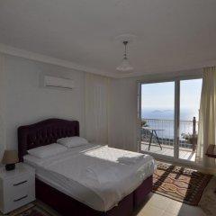 Villa MNM Турция, Калкан - отзывы, цены и фото номеров - забронировать отель Villa MNM онлайн комната для гостей фото 3