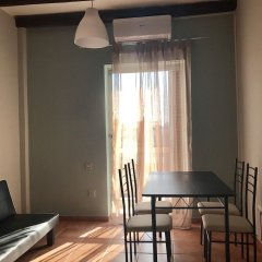 Апартаменты Perfect sea view apartment in Voula комната для гостей фото 4