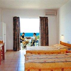 Отель Sofia Mythos Beach Aparthotel Греция, Милопотамос - 1 отзыв об отеле, цены и фото номеров - забронировать отель Sofia Mythos Beach Aparthotel онлайн комната для гостей фото 2