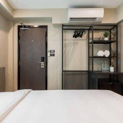 Отель Lucky House сейф в номере