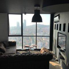 Отель Dumankaya Ikon 32 Floor 2 Bedrooms комната для гостей