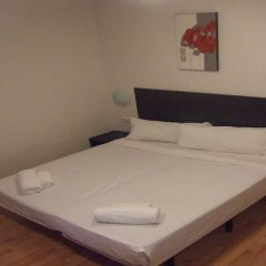 Апартаменты Km1 Atocha Apartments комната для гостей