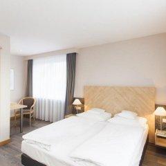 Отель BURNS fair & more комната для гостей